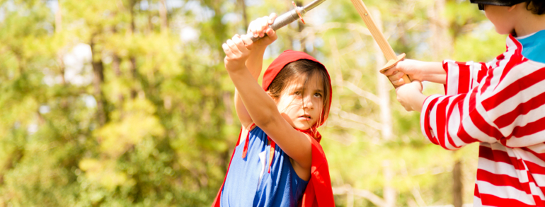 girl in cape with sword