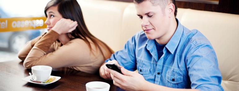 man-on-phone-ignoring-woman